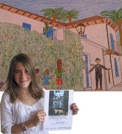 Ana Ruiz, del CEIP San Francisco (Cájar) junto a su dibujo